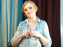 Seductive milf librarian fucks her tight aged pussy with a spiky rubber toy
