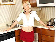 Petite blonde cougar Heidi Hanson stuffs a thick dildo in her furry pussy